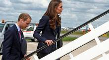 Prince William and Catherine, Duchess of Cambridge, board a plane bound for Canada at London's Heathrow Airport on June 30, 2011. (WPA Pool/Getty Images)