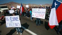 Striking copper miners at Chile's Escondida mine hold a protest. (FRANCESCO DEGASPERI/AFP/Getty Images)