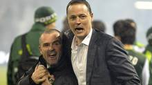 Head coach John Spencer of the Portland Timbers celebrates with the owner Merritt Paulson of the Portland Timbers after they won their home opener 4-2 at Jeld-Wen Field on April 14, 2011 in Portland, Oregon. The Timbers won the game 4-2.(Photo by Steve Dykes/Getty Images) (Steve Dykes/Getty Images)