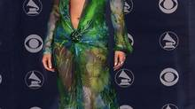 Singer and actress Jennifer Lopez poses in her revealing gown backstage at the 42nd annual Grammy Awards in Los Angeles February 23, 2000. (HO/REUTERS)