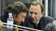 Edmonton Oilers owner Daryl Katz, left, speaks with NHL Commissioner Gary Bettman during a game on Feb. 19, 2011. (John Ulan/The Canadian Press)