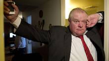 Toronto Mayor Rob Ford tours a Toronto Community Housing building on March 12, 2014. (MATTHEW SHERWOOD FOR THE GLOBE AND MAIL)