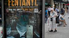 People walk past a bus shelter advertisement warning of the dangers of fentanyl on Granville Street in Vancouver, B.C., on Wednesday August 12, 2015. DARRYL DYCK FOR THE GLOBE AND MAIL (DARRYL DYCK For The Globe and Mail)