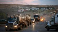 Traffic generated by an oil boom lines the main street in Watford City, North Dakota, U.S., on Tuesday, Oct. 11, 2011. Oil production in the state has tripled in five years, attracting the likes of Exxon Mobil Corp., and Norway's Statoil ASA. (Matthew Staver/Bloomberg)
