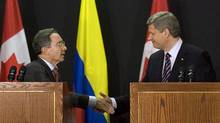 Prime Minister Stephen Harper shakes hands with Colombian President Alvaro Uribe after Canada signed a free trade agreement with Colombia in November, 2008. (ANDREW VAUGHAN/ANDREW VAUGHAN/THE CANADIAN PRESS)