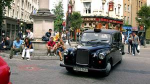 A London taxi makes its way around the Seven Dials roundabout at Covent Garden in London. Commonly found throughout Europe, the roundabout, also known as a traffic circle, is becoming more common throughout the United States. British drivers argue that roundabouts are safer and far more efficient than traffic lights.