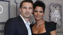 Actress Halle Berry and Olivier Martinez pose at Variety's 4th Annual Power of Women event in Beverly Hills, Calif., on October 5, 2012. (MARIO ANZUONI/REUTERS)