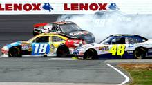 Denny Hamlin, driver of the No. 11 FedEx Small Business Toyota spins out behind Jimmie Johnson, No. 48, and Kurt Busch, No. 18, during the NASCAR Sprint Cup Series Sylvania 300 at New Hampshire Motor Speedway on September 19, 2010 in Loudon, New Hampshire. (Jeff Zelevansky/Getty Images)