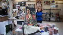 Mosaic artist Lilian Broca displays one of the scarves based on her artwork as she sits for a photograph at her home studio in Vancouver last Friday. (DARRYL DYCK FOR THE GLOBE AND MAIL)