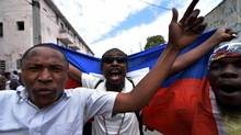 Demonstrators march during a protest in Port-au-Prince, on January 22, 2016. (HECTOR RETAMAL/AFP/Getty Images)