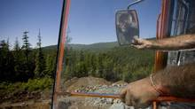 Ron Vanderkhove breaks up rock in a quarry on the Western Forest Product lot in this file photo. (JOHN LEHMANN/The Globe and Mail)