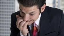 Nervous businessman. (Jared DeCinque/Getty Images/iStockphoto)