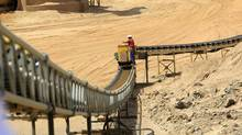 A worker is pictured next to a conveyor belt at the Ariab mine September 28, 2011. The Ariab mine in east Sudan's Red Sea state, the country's largest single gold mining operation, is run by a partnership between Sudan's government and Canada's La Mancha. Sudan plans to more than double its gold output in two years partly to help make up for a possible fall in oil revenues after the independence of its crude-oil producing south in July, Sudan's Minerals Minister Abdelbagi Gailani Ahmed said in April. (MOHAMED NURELDIN ABDALLAH/Reuters/MOHAMED NURELDIN ABDALLAH/Reuters)