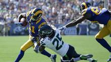 Richard Sherman #25 of the Seattle Seahawks takes down Tavon Austin #11 of the Los Angeles Rams during the second quarter of the home opening NFL game at Los Angeles Coliseum on September 18, 2016 in Los Angeles, California. (Jeff Gross/Getty Images)