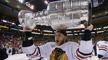 Chicago Blackhawks' Patrick Kane celebrates with the Stanley Cup after the Blackhawks defeated the Boston Bruins in Game 6 of their NHL Stanley Cup Finals hockey series in Boston, Massachusetts, June 24, 2013. (BRIAN SNYDER/REUTERS)
