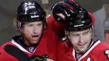 Chicago Blackhawks Brian Campbell (L) celebrates his goal against Vancouver Canucks with team mates Patrick Sharp (C) and Jonathan Toews during the second period in Game 4 of their NHL Western Conference quarter-final hockey game in Chicago, April 19, 2011. REUTERS/John Gress (JOHN GRESS)