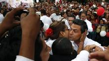 A woman kisses Enrique Pena Nieto, presidential candidate of the opposition Institutional Revolutionary Party (PRI), during a political rally in Oaxaca April 10, 2012. (Jorge Luis Plata/ Reuters)