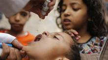 A boy receives polio vaccine drops on the outskirts of Yemeni capital Sanaa on Aug. 11, 2014. (Khaled Abdullah/REUTERS)