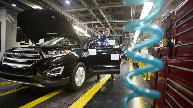 Employees with Ford Edges on the line following Ford's official kick-off of the new 2015 Ford Edge production at the assembly plant in Oakville, Ontario on Thursday, February 26, 2015.