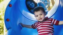 It's best to send a child down a slide alone, some doctors say. (Jupiterimages/Getty Images/Brand X)
