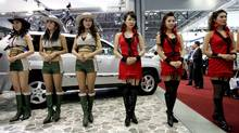 South Korean models stand during a press day of the Seoul Motor Show in Goyang, west of Seoul, South Korea in 2007. (Ahn Young-joon/AP Photo)