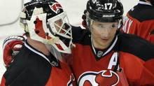 New Jersey Devils' Ilya Kovalchuk (17), of Russia, hugs goaltender Martin Brodeur after they defeated the New York Islanders 5-1 in an NHL hockey game on Thursday, March 8, 2012, in Newark, N.J. (AP Photo/Bill Kostroun) (Bill Kostroun/AP)