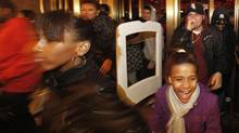 Crowds of shoppers rush through the doors of Macy's in search of Black Friday bargains. (FINBARR O'REILLY/Finbarr O'Reilly/Reuters)