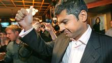 A dejected Rahim Jaffer gives the thumbs up after falling behind in the Edmonton-Strathcona riding at Tory headquarters on Oct. 14, 2008. (Perry Mah)