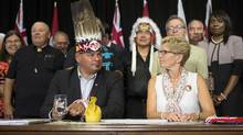 Ontario Regional Chief Isadore Day (left) sits with Ontario Premier Kathleen Wynne as they sign an accord with at the Ontario Legislature in Toronto on Monday, August 24 2015. (Chris Young/THE CANADIAN PRESS)