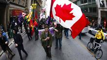 "Protesters march down Yonge Street during the ""Occupy Toronto"" movement in Toronto, November 19, 2011. (MARK BLINCH/REUTERS)"