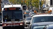A TTC bus battles traffic on Eglinton Avenue. (Deborah Baic/The Globe and Mail/Deborah Baic/The Globe and Mail)