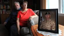 Micheline and Phillip Reed with a photograph of their son, Corporal Anthony A. Reed on October 22, 2016 in Ottawa. (Dave Chan for The Globe and Mail)