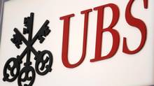 The UBS logo is seen at the UBS 40th Annual Global Media and Communications Conference in New York, Dec. 5, 2012. (CARLO ALLEGRI/REUTERS)