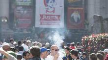Thousands attend a 4-20 event in downtown Vancouver, B.C., on Monday, April 20, 2015. (JONATHAN HAYWARD/THE CANADIAN PRESS)