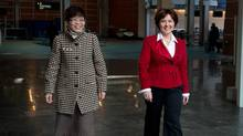 British Columbia Premier Christy Clark (right) and Teresa Wat, Minister of International Trade and Minister Responsible for the Asia Pacific Strategy and Multiculturalism, arrive to speak at Vancouver International Airport in Richmond, B.C., on Nov. 21, 2013. The B.C. government will repeal 19 pieces of historical legislation that contain discriminatory provisions – acts passed between 1881 and 1930 that forbid employing Chinese or Japanese people. (DARRYL DYCK For The Globe and Mail)