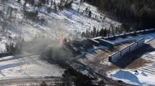 Derailed train cars burn in Plaster Rock, N.B., on Jan. 8, 2014. (TOM BATEMAN/THE CANADIAN PRESS)