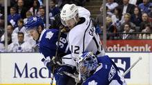 Toronto Maple Leafs goalie James Reimer (R) kicks the puck away from defenceman Carl Gunnarsson (L) and Los Angeles Kings forward Simon Gagne during the first period of their NHL hockey game in Toronto December 19, 2011. (Mike Cassese/Reuters/Mike Cassese/Reuters)