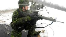 A female Canadian officer cadet on a shooting range in Farnham, Que., in this photo from 2009. (John Morstad for The Globe and Mail)
