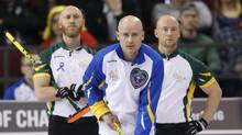 Team Alberta skip Kevin Koe (C) watches his team's shot as Team Northern Ontario skip Brad Jacobs (L) and third Ryan Fry look on during their semi-final game at the Brier curling championships in Ottawa, Canada, March 12, 2016. (CHRIS WATTIE/REUTERS)
