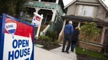 Potential buyers arrive at an open house in the Strathcona neighbourhood of Vancouver. (Rafal Gerszak For The Globe and Mail)