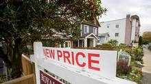 A sign outside a house for sale in Vancouver on Tuesday. Early data from the B.C. government show the number of foreign buyers in the Vancouver area's housing market dropped in the first month of the tax. (Ben Nelms for The Globe and Mail)