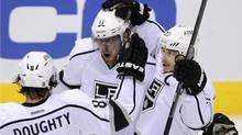 Los Angeles Kings center Anze Kopitar (C) celebrates his 1st period goal against the Phoenix Coyotes with teammates Drew Doughty (8) and Dustin Brown (23) during Game 5 of the NHL Western Conference hockey finals in Glendale, Arizona, May 22, 2012. REUTERS/Todd Korol (TODD KOROL)