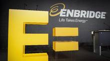 Enbridge company logos on display at the company's annual meeting in Calgary, Thursday, May 12, 2016. (Jeff McIntosh/THE CANADIAN PRESS)