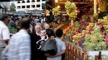 Palestinians shop at a market ahead of the start of the Muslim holy fasting month of Ramadan in the West Bank city of Ramallah. (ABBAS MOMANI/ABBAS MOMANI/Getty)