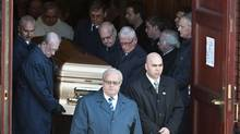 Pallbearers bring the casket of mafia kingpin Nicolo Rizzuto Sr. out of the Notre-Dame-de-la-Defense church in Montreal, Canada November 15, 2010 following his funeral. The 86-year-old patriarch was gunned down Wednesday at his home in what appeared to be a carefully orchestrated hit. (Rogerio Barbosa/AFP/Getty Images/Rogerio Barbosa/AFP/Getty Images)