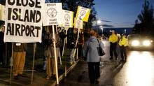 Monday, Oct.23/06 . Protesters at the foot of Bathurst street near Queens Quay protesting the start of Porter Airlines service. (Tibor Kolley/The Globe and Mail)