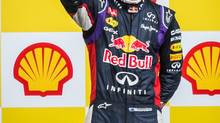Red Bull driver Daniel Ricciardo of Australia won the race, Mercedes driver Nico Rosberg of Germany finished second and Williams driver Valtteri Bottas of Finland third. (Geert Vanden Wijngaert/Associated Press)