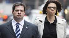 James Forcillo (left) arrives at court with his wife Irina in Toronto on Tuesday April 22 , 2014. (Chris Young/THE CANADIAN PRESS)