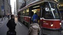 Mayor John Tory first revealed details of his TTC plan last month, which includes 50 new buses, reduced waiting times and free fares for kids aged 12 and under. (Fred Lum/The Globe and Mail)