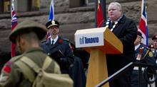 Toronto Mayor Rob Ford spoke during the Remembrance Day Ceremonies at Old City Hall in Toronto on Nov. 11, 2013. (Deborah Baic/The Globe and Mail)
